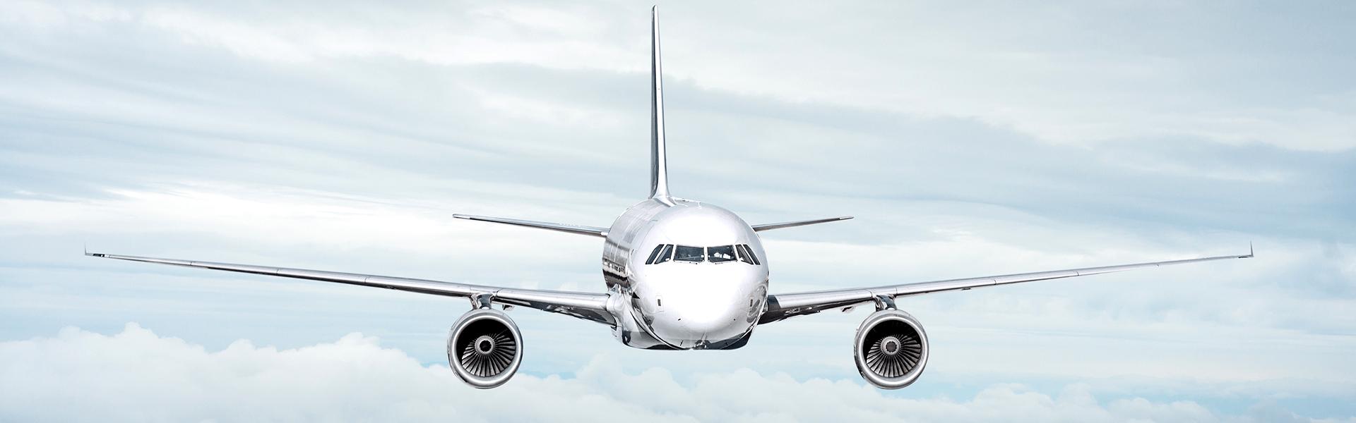 Passenger jet air plane flying on blue sky