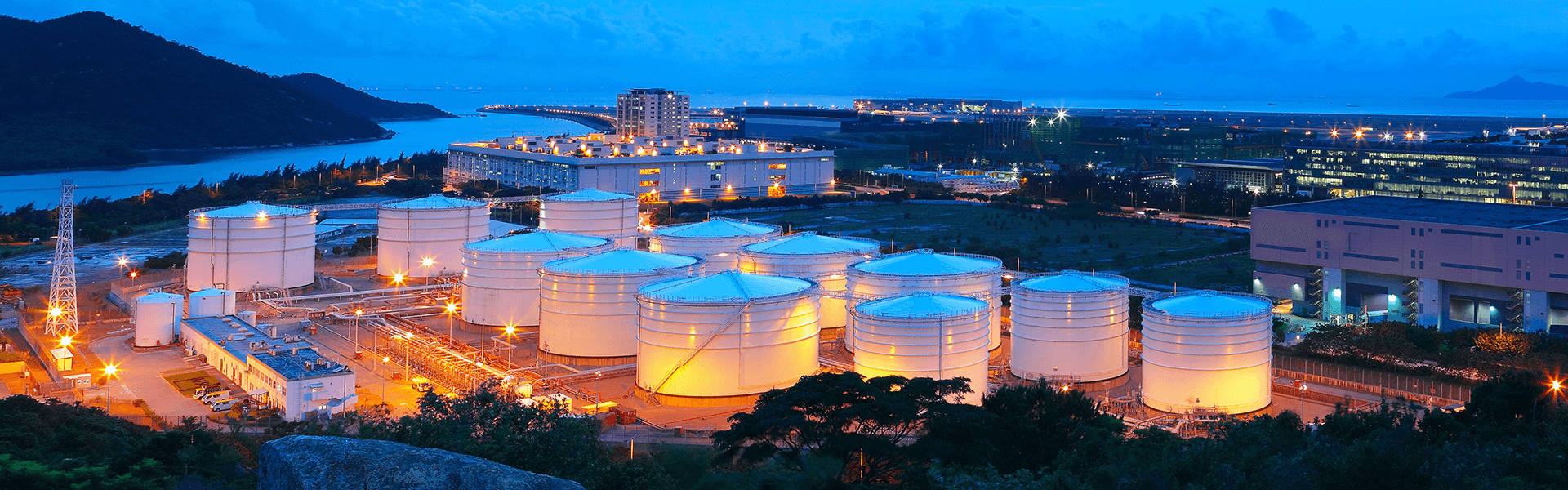 Gas tanks at night